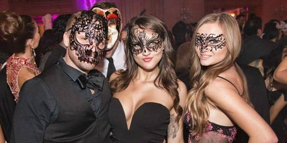 What is the concept of a masquerade ball?