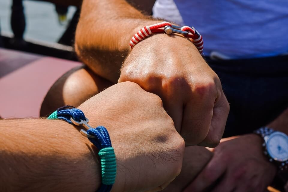 Sharing a friendship bracelet for a strong relationship with a loved one